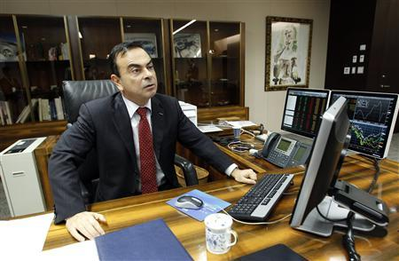 Carlos Ghosn, Chairman and CEO of Renault-Nissan Alliance, sits at his desk during a photo opportunity after an interview with Reuters at Nissan headquarters in Yokohama, south of Tokyo February 25, 2011.